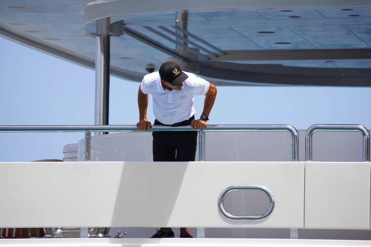 Deckhand looking down the superyacht side