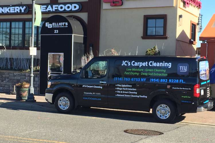 JC's Carpet Cleaning van parked in a parking spot.