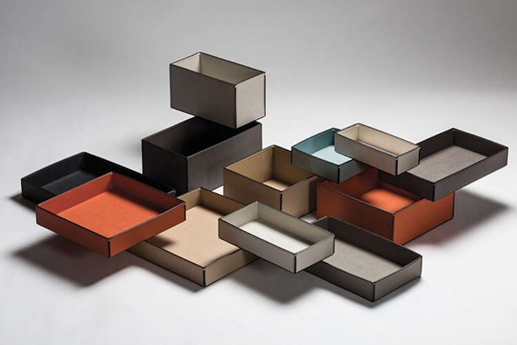 Different sizes and colours of trays and boxes laid on top of each other