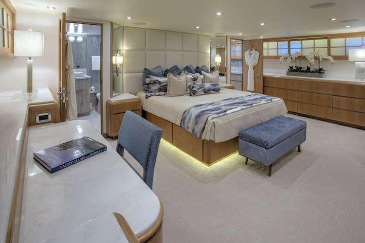 Superyacht master bedroom with interior design by Karen Lynn.