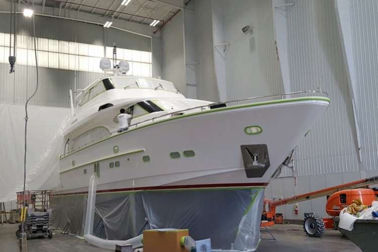 A yacht being refitted in a shipyard