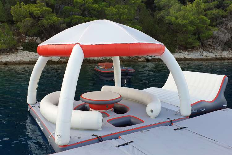 Party Bana with a roof and seating area floating in a lake