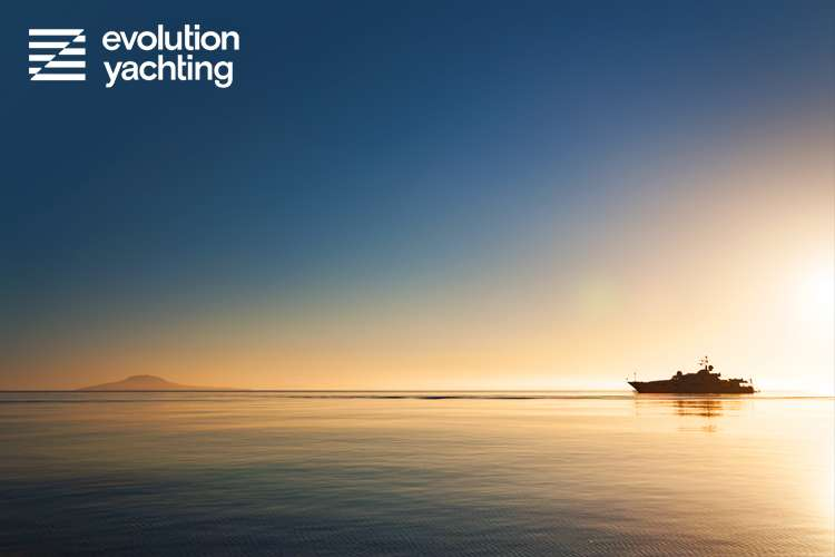 Superyacht in the sunset with calm water