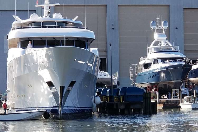 Superyacht docking at a shipyard
