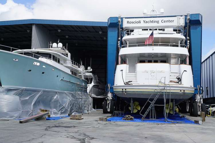 Yacht being lifted to a hangar