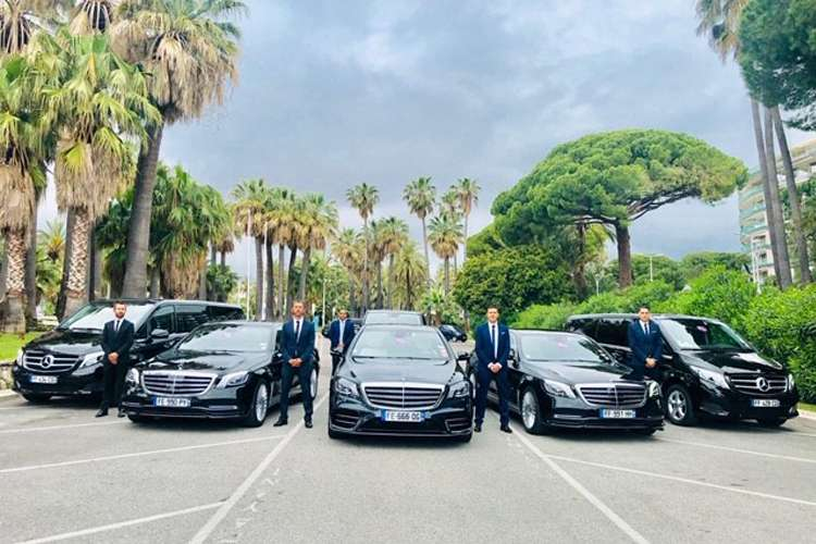 All the Kingdom Limousine luxury cars lined up in a row