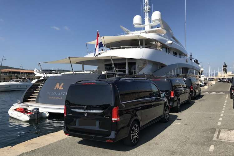 Black Ruby Services Mercedes van parked in front of a berthing superyacht