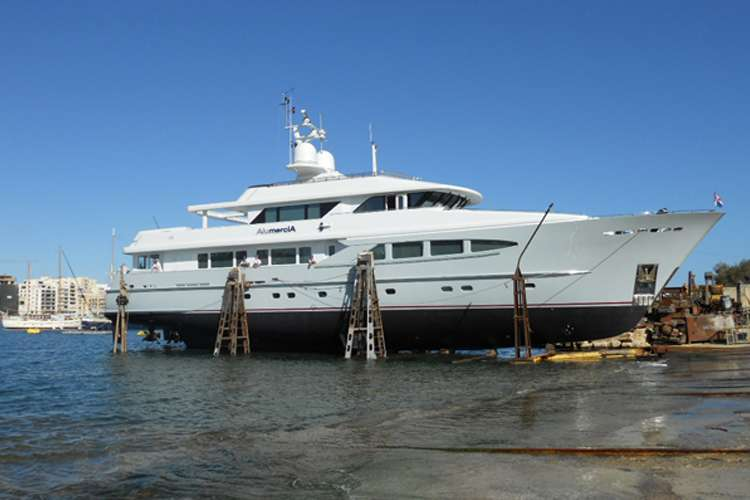 Image of a superyacht lifted from water at the Manoel Island shipyard