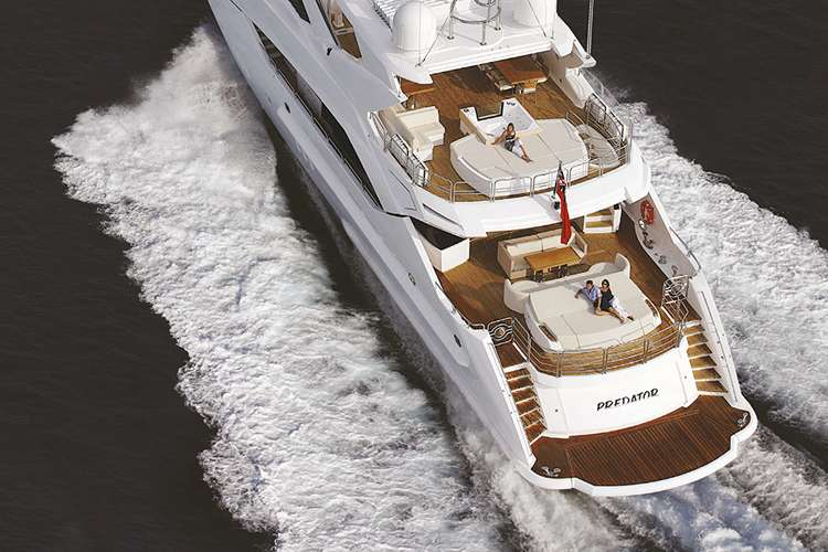 Aerial image of a stern of a superyacht cruising
