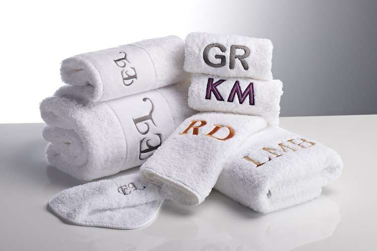 Monogram embroiled towels from Heirlooms in a pile.