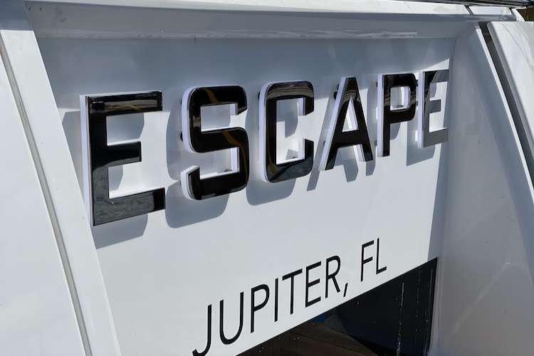 Yacht lettering on superyacht Escape